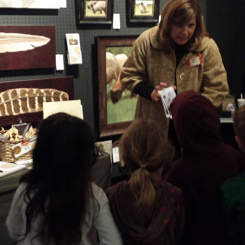 Amy explaining her art process to young artists at the 2013 USN show.